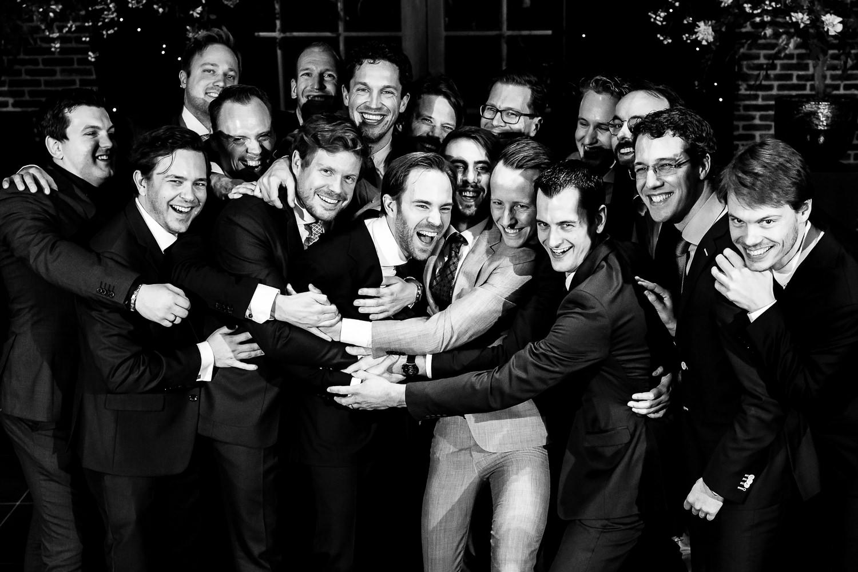 Zwart witte groepsfoto met de mannen